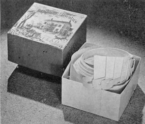 A Post Bellum Collar Box: This container with paper collars still within, displays a colored print of Lincoln's home on its cover. The box is of paper and was made in 1868.
