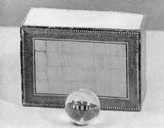 Quartz Crystal Marble and Trick Box: Each box was complete with two of these marbles. Box and marbles were widely sold in better toy stores of the United States about sixty years ago.