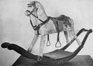 A Rocking Horse Made After 1860: Painted a dapple grey, it is complete with saddle and bridle of the period and is an excellent example of the larger toys of the period.