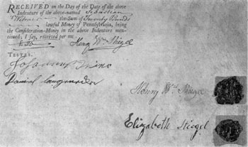"The Signatures of Stiegel and His Wife: From an indenture of 1774 to Sebastian Witmer, one of his glass enamelers. Printed on vellum, it designates Stiegel as ""Glass-Manufacturer."" Stiegel's seal is a cipher of his initials; his wife's, a bird with an olive branch. It is for land near Manheim. Price 20 pounds, Pennsylvania money."