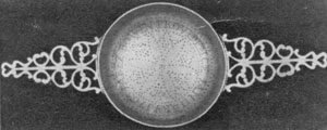 "Illustration III: Strainer Dated 1765: It was made by Jonathan Clarke, 1705-1770, who worked first in Newport and later in Providence. It has a perforated inscription reading, ""Jabez Bowen, Providence, January 1765."""