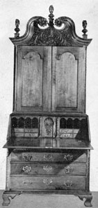 Walnut Secretary Made by Jacob Bachman Between 1766 and 1770: All of the carving, treatment of the bonnet top, and desk interior are characteristic of his work. The folio drawers on either side of central closet of the interior have boldly carved pilaster fronts and are wooden pegged instead of being dove-tailed together. In the base, dust boards separate each drawer space, which is considered unusual in American furniture.