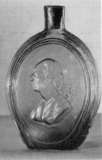 Illustration II: Washington Profile: Classical bust with queue, faces left. Quart size. Possibly made at Baltimore Glass Works or Bridgeton Glass Works. Found in clear glass, clear dark amber, blue, aquamarine, pale honey, emerald green, and honey amber colors.