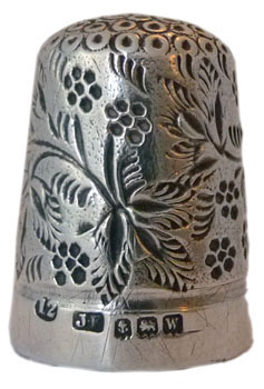 """James Fenton is known for his blackberry designs - here with an all over pattern of leaves with the berries. There are also stylised berries on the apex. Marked with size 12,""""JF"""" maker's mark, assay mark for Birmingham 1921."""
