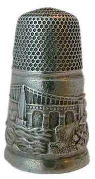 A very early pictorial Victorian s/s thimble showing the Menai bridge in wonderful detail on a very wide band and all round. Note the tall elegant narrow shape which typifies the earlier Victorian silver thimbles. A very rare thimble.