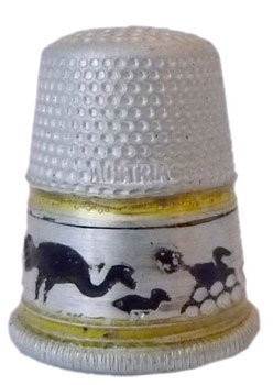 Settmacher. Made of aluminium with a band showing ostriches in black. 'Austria' is lettered into the indentations. From the 1920s