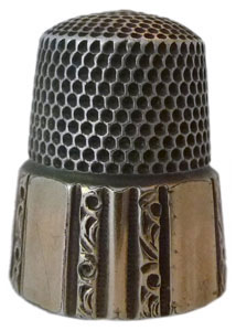 "Simons marked up in the apex with ""S"" maker's mark - they still produce thimbles in Philadelphia - with a panelled, gold band over sterling silver - from 1880s."