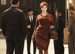 Joan Holloway (Christina Hendricks) is the Office Manager at the Sterling Cooper advertising agency.
