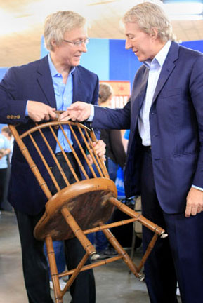 Leigh Keno, President of Leigh keno American Antiques, and Leslie Keno, Senior Vice President and Director of American Furniture and Decorative Arts at Sotheby's, evaluate a wooden chair. The brothers traveled to San Jose to appraise Furniture.