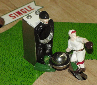 Detail of animated metal umpire and pitcher from Official Baseball by Williams 1960.