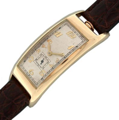 This Movado Polyplan from 1935 features a 14K yellow gold case whose shape curves with the wrist.