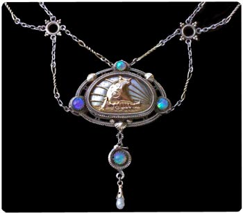 Sailing ship pendant (a ubiqitous motif in Arts & Crafts Jewelry) by the Artificer's Guild. Silver and opals. Note the festoon style chain. Photo courtesy Tadema Gallery, London.