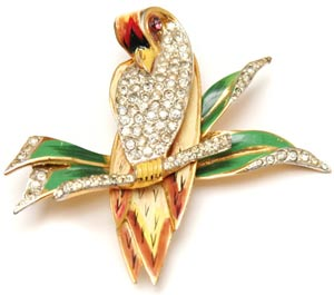 This CoroCraft brooch, circa 1940, uses pavé-set rhinestones to contrast with the feathers and leaves that have been painted on the pin's sterling base.