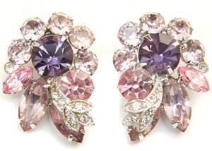 These Eisenberg Ice earrings from around 1950 include lilac, pink, and clear rhinestones, some of which are pavé-set.