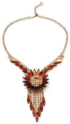 For this bold, sunburst necklace, Juliana designers placed Colorado topaz navette rhinestones around a core of aurora borealis gems, which dates the piece to about 1960.