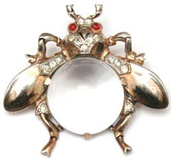 Many Trifari Jelly Bellies from the 1950s were relatively simple, such as this fly brooch made of sterling vermeil, diamante accents, and red cabochon eyes.