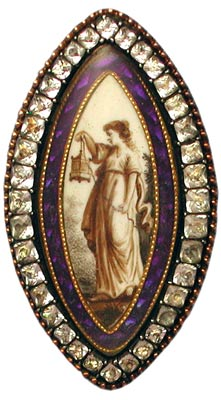 The woman in this brooch with paste edging is holding a lantern, as if to light the way for one's encounter with one's maker.