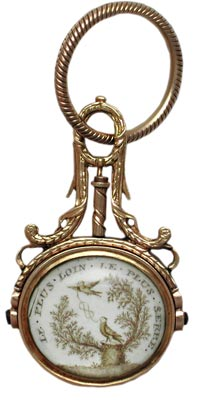 "In this French watch fob, a husband's dedication to his late wife reads, ""the further apart, the tighter the bond."""