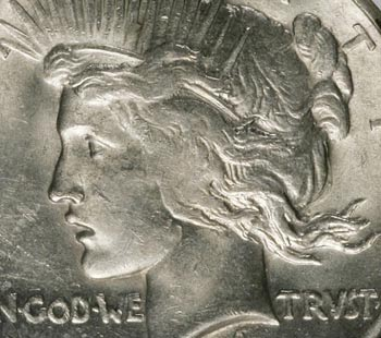 The detail on many 1921 dollars is weak; this example with mushed-out hair is typical.