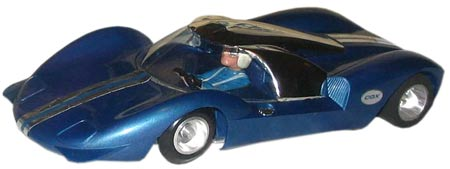 "Cox's La Cucaracha GT was marketed as the Super ""Cuc."" Its blue polypropylene body had front fins and a slot in the engine compartment to receive the tab holding the roof."