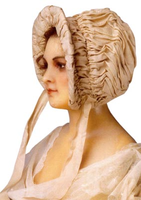 Known as a Jane Austen bonnet, this circa 1812 piece is made of raw silk draped and shirred over a wire frame.