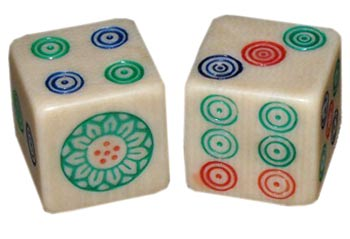 A pair of French ivory dice, probably distributed by Piroxloid.