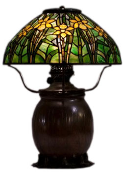 Tiffany lamp appraiser arlie sulka an interview with collectors this daffodil inspired tiffany lampshade sits on a swamp pattern base aloadofball Image collections