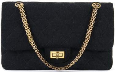 A Chanel Black Fabric Quilted Purse, 1960s, with goldtone straps and closure, back pocket, double flaps, fully lined in crimson CC logo lining.  Stamped: Chanel.