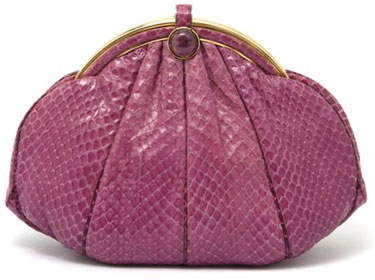 A Judith Leiber Pink Snakeskin Evening Bag, in a round shape with gold hardware and cabochon closure, hidden strap with change purse. Stamped: Judith Leiber.