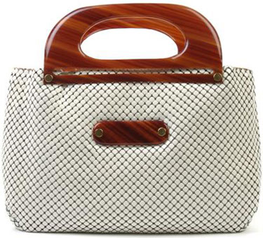a9b13efb6af3 Whiting and Davis was a big name for purses in the 1920s. This white mesh  number has tortoise resin handles and two interior pockets.