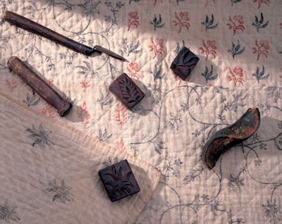 Printing blocks and tools on a pieced quilt. Bequest of Henry Francis du Pont.