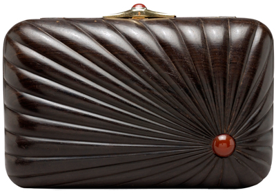 Though her factory was in New York, Leiber shopped the globe for the best materials and artisans. For example, this ebony box from 1981 was carved in India but features Italian hardware. Cornelians accent the lock and side of the box.