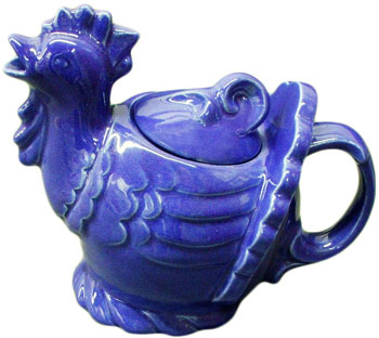 The designer of this Blue Rooster teapot is uncertain, but it may have been Belle Kogan. The teapot was introduced in 1944 but was dropped from production, along with most other Gypsy Trail Hostess Ware items, around the end of World War II.