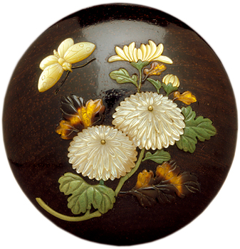 Here, chrysanthemums and a butterfly are inlaid in ivory, tortoiseshell, and mother of pearl.
