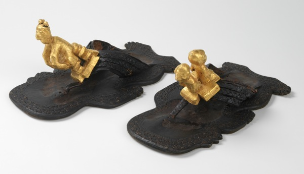 This circa-1930 example from Ghana was worn by the Asantehene of Kumasi and features soles in the shape of human figures and gold-leafed ornaments.