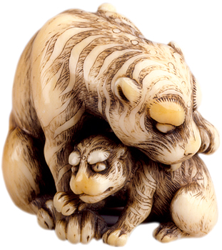 Though famous for his oxen, 18th-century artist Tomotada carved other animals, such as this ivory tiger and her cub.