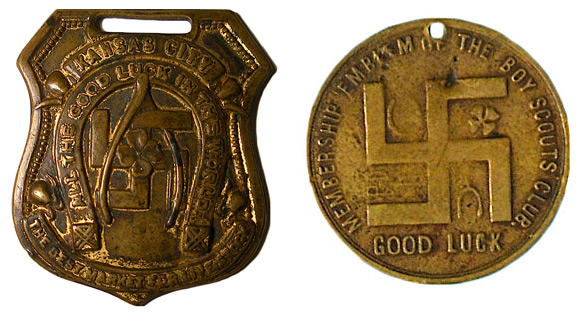 8. On the left, a pre-1920s good-luck watch fob touting the virtues of Kansas City's livestock market. On the right, a pre-Nazi-era membership emblem distributed by the Boy Scouts.