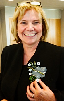 Judith Miller wears the pin Larry Vrba designed especially for her.