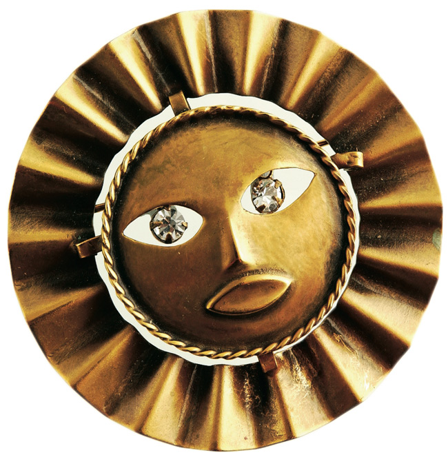 "This Joseff of Hollywood ""Moon God With Ruff"" brooch is one of Miller's favorites. Its rhinestone eyes move."