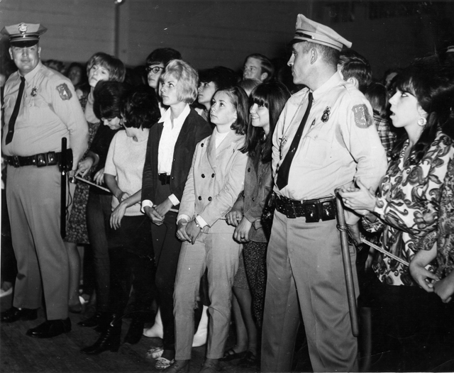 The crowd and security at an early Rollarena show.