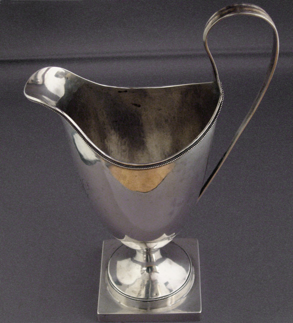 Vermont is not known for hollowware. This coin silver helmet creamer was made by Daniel Bloom Coen of New York.