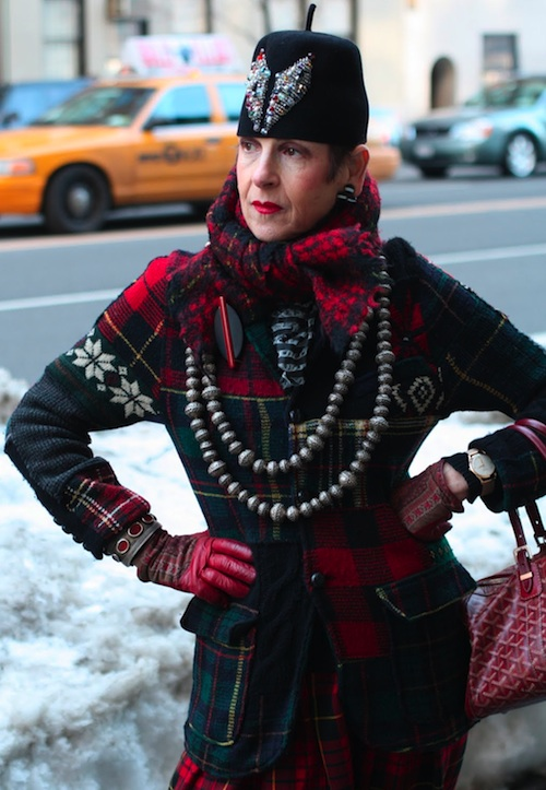 A plaid Ralph Lauren jacket is paired with plaid Comme Des Garçons pants and scarf. The beads originated in Baku, Azerbaijan, the pin is Bakelite and wood, and the gloves (now lost) are paisley and red leather.