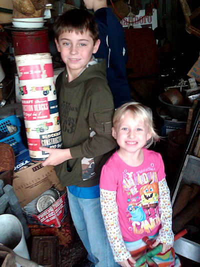 Nine-year-old Jacob Dick, with his 4-year-old sister, Aubrie, finds a container of Blockraft construction blocks.