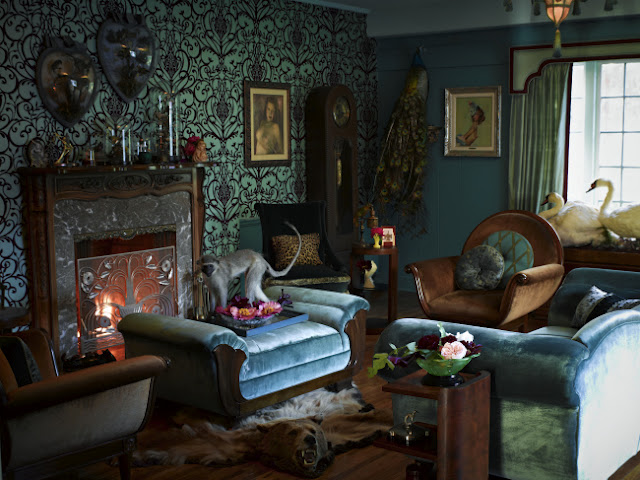 Von Teese's living room is decked with taxidermy: two heart-shaped bird domes, a monkey, a peacock, two swans, and a bearskin rug. Photo by Douglas Friedman for the February 2011 issue of InStyle.