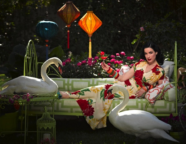 Von Teese in her backyard with her taxidermied swans. Photo by Douglas Friedman.