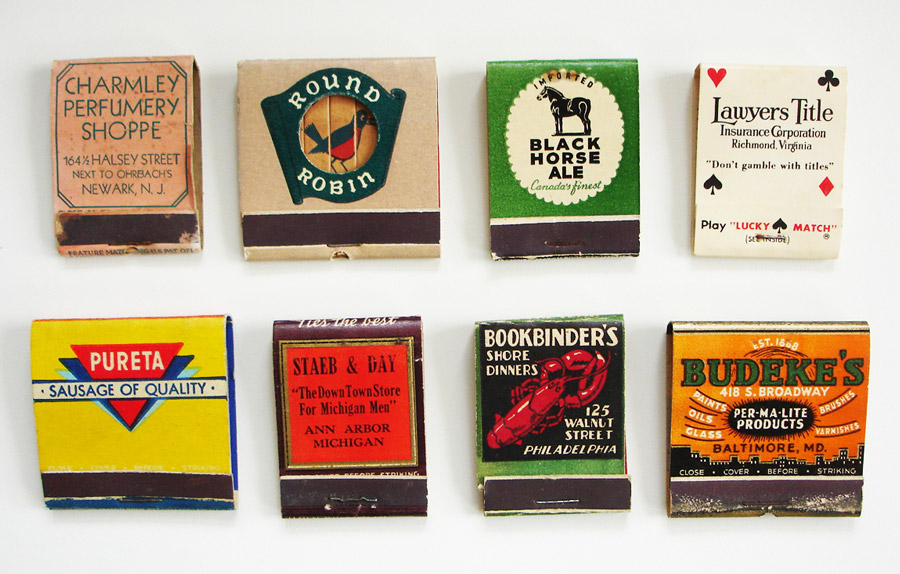 Matches as lipsticks, robins, beers, sausages, ties, paint brushes, and a lobster, from a collection belonging to Lea Redmond of Leacutter Designs. The Lawyer Title book (top right) could be used to play a gambling game. Click image below to see the matches up close. Photos by Redmond.