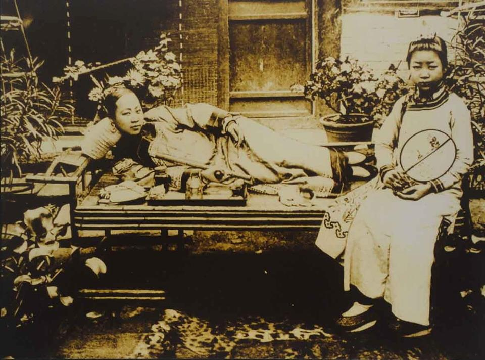Women smoking opium in China, circa 1900.