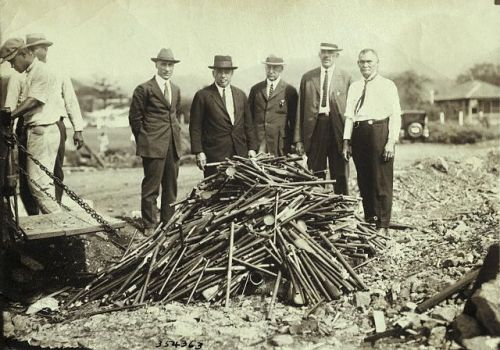 Confiscated opium pipes in Hawaii are piled up and readied for burning in this photo, circa 1920.