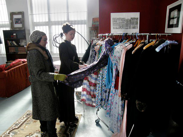Thompson helps a woman pick out vintage dresses at the Parlour. Via the Vintage Secret Facebook page.