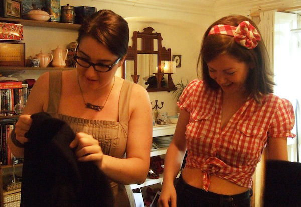 Thompson, right, selects clothes for Young to try out. Via Gabby Young's Style Blog.